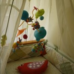 Mobile from Amy and Andy in the canopy over the crib. Cuteness overload.
